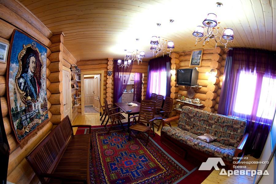 Дом из бруса оцилиндрованное бревно эксклюзивное фото