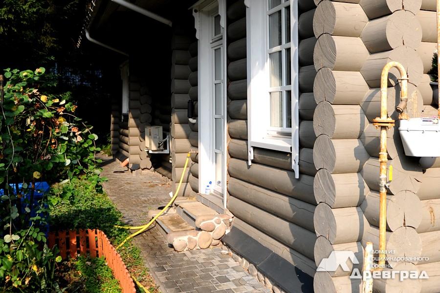 Деревянные дома из оцилиндрованного бруса фото