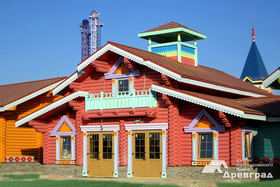 Конопатка дома из оцилиндрованного бревна фото