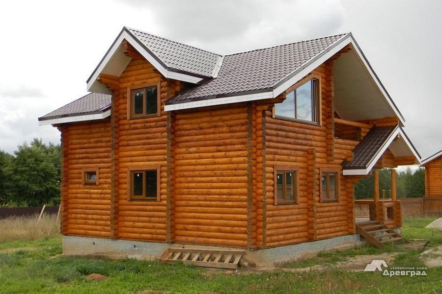 Производство домов из оцилиндрованного бруса фото