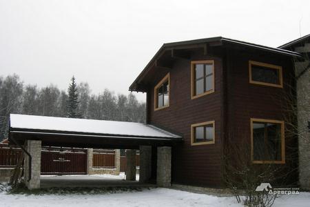 Конопатка дома из оцилиндрованного
